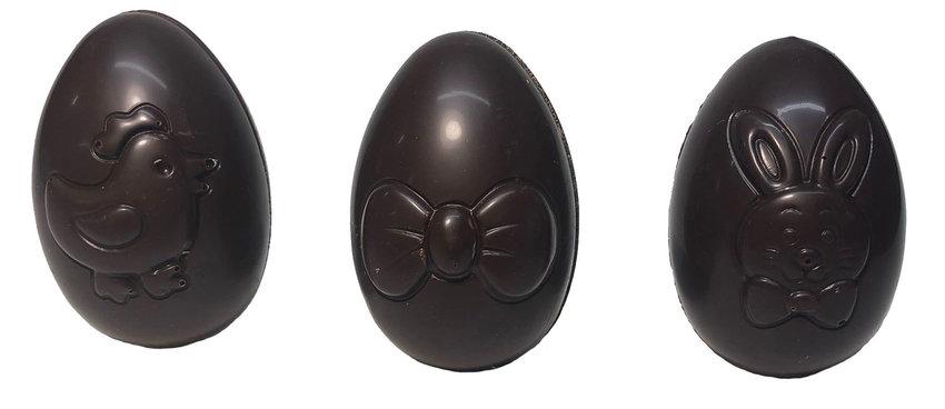 Assortment of hollow, playful eggs, dark chocolate